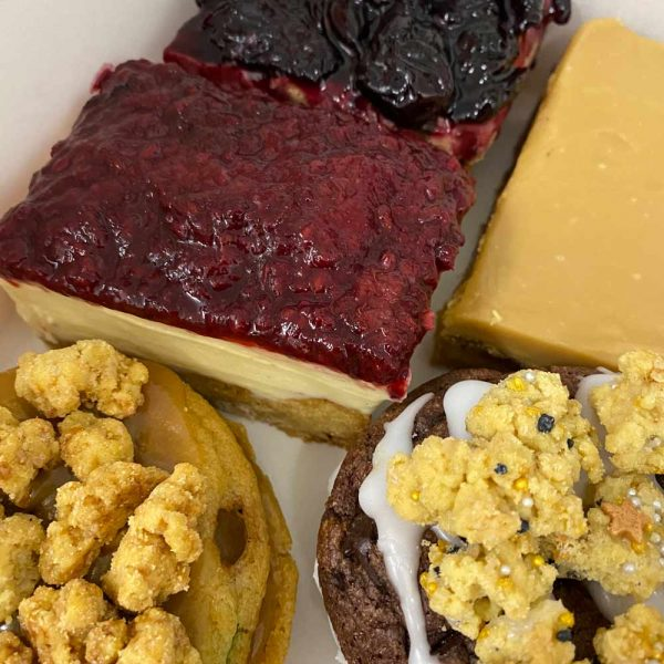 Treat boxes cookie sandwich and cheesecakes